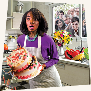 A Black woman in her kitchen about to drop a cake with white people looking from outside the window